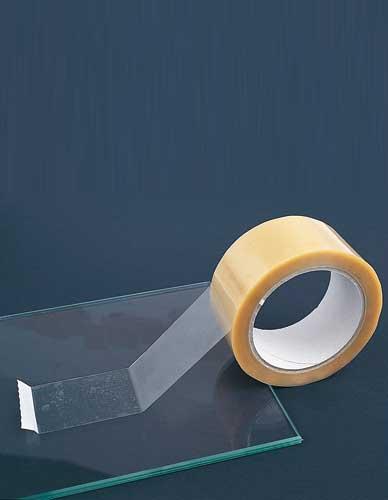 Adhésif léger pour la protection des verres
